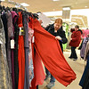 Erin Linenberger finds a formal long dress for under $50 at Dillards during the FRIENDS of Broomfield scavenger hunt at FlatIron Crossing mall on Thursday.<br /> February 14, 2013<br /> staff photo/ David R. Jennings