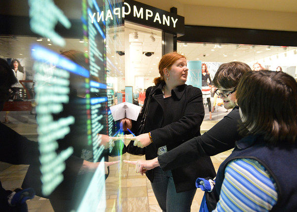 Erin Linenberger, left, Tamra Wobermin and Christina Swiheart consult the store directory to help them plan where to go next during the FRIENDS of Broomfield scavenger hunt at FlatIron Crossing mall on Thursday.<br /> February 14, 2013<br /> staff photo/ David R. Jennings
