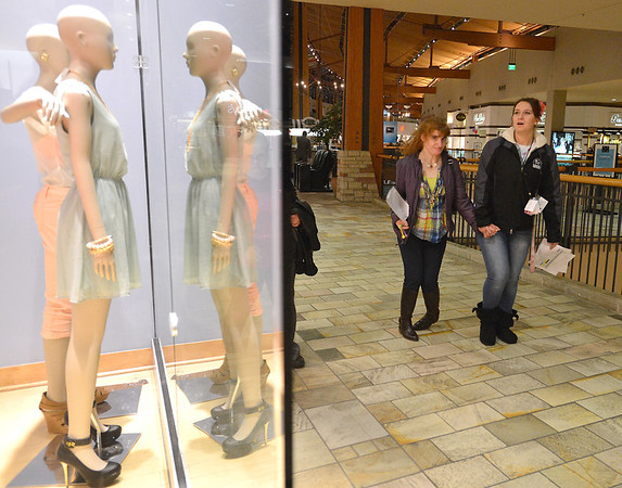Kyla Roberts, left, walks with staff member Nikki Smith as they help their group look for items duirng  the FRIENDS of Broomfield scavenger hunt at FlatIron Crossing mall on Thursday.<br /> February 14, 2013<br /> staff photo/ David R. Jennings
