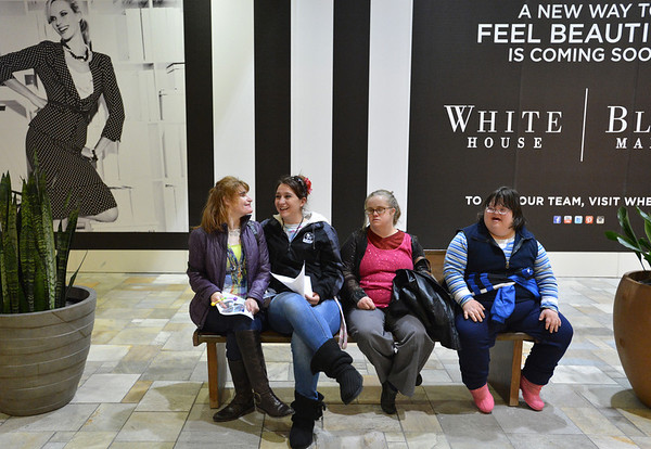 Kyla Roberts, left, staff member Nikki Smith, Meghan Doherty and Christina Swiheart rest on a bench during the FRIENDS of Broomfield scavenger hunt at FlatIron Crossing mall on Thursday.<br /> February 14, 2013<br /> staff photo/ David R. Jennings