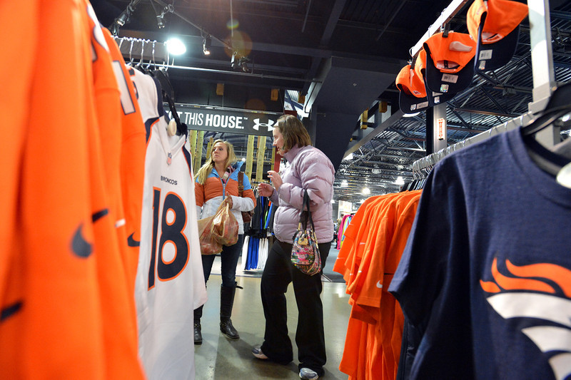 Molly Coufal, left, evening /social director, and Mary Koch look for a Bronco's jersey that fits the correct price on their list at Dick's Sporting Goods during the FRIENDS of Broomfield scavenger hunt at FlatIron Crossing mall on Thursday.<br /> February 14, 2013<br /> staff photo/ David R. Jennings