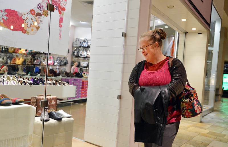Meghan Doherty looks at shoes while searching for items during the FRIENDS of Broomfield scavenger hunt at FlatIron Crossing mall on Thursday.<br /> February 14, 2013<br /> staff photo/ David R. Jennings