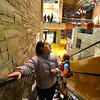 Mary Koch rides the escalator while helping her group find items during the FRIENDS of Broomfield scavenger hunt at FlatIron Crossing mall on Thursday.<br /> February 14, 2013<br /> staff photo/ David R. Jennings