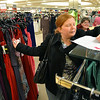 Erin Linenberger writes down the price of a long gown she found at Dillards that was under $50 during the FRIENDS of Broomfield scavenger hunt at FlatIron Crossing mall on Thursday.<br /> February 14, 2013<br /> staff photo/ David R. Jennings