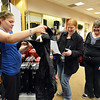 Kristen Wastart, left, with Colorado Baggage, helps Erin Linenberger and Tamra Wobermin find a rain coat to add to their list during the FRIENDS of Broomfield scavenger hunt at FlatIron Crossing mall on Thursday.<br /> February 14, 2013<br /> staff photo/ David R. Jennings