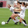 FAIRVIEW04<br /> Fairview's Janina Korba, far left, and Keelyn Arnold, right, fight for the ball against Blair Larson of Arapahoe.<br /> <br /> Photo by Marty Caivano/Camera/May 26, 2010