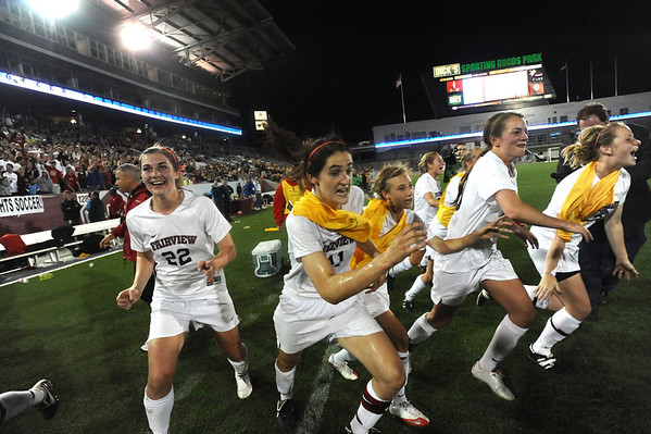 FAIRVIEW<br /> Fairview's players take to the field as the clock runs out on their win over Arapahoe in the state 5A championships.<br /> Photo by Marty Caivano/Camera/May 26, 2010