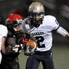 Legacy's Cameron McWee carries the ball downfield avoiding a tackle by Fairview during Saturday's game at Reicht Field.<br /> October 1, 2011<br /> staff photo/ David R. Jennings