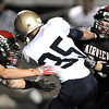 Fairview's Colin Brown, left, and Keaton Von Eschen tackle Legacy's Collin Randallduring Saturday's game at Reicht Field.<br /> October 1, 2011<br /> staff photo/ David R. Jennings