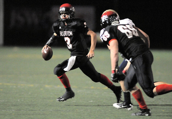 Fairview's quarterback Michael McVenes runs the ball to pass against Legacy during Saturday's game at Reicht Field.<br /> October 1, 2011<br /> staff photo/ David R. Jennings