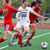 FVHS09<br /> Fairview's Caitlin Higgins gets the ball past Emily Fretz  of Smoky Hill.<br /> Photo by Marty Caivano/Camera/May 18, 2010
