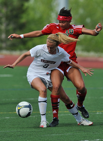 FVHS06<br /> Fairview's Ali Mullin collides with Candace Cephers of Smoky Hill.<br /> Photo by Marty Caivano/Camera/May 18, 2010