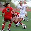 FVHS08<br /> Fairview's Charlotte Hogenson eludes Smoky Hill players Kelsey Morales, left, and Michaela Herrmann.<br /> Photo by Marty Caivano/Camera/May 18, 2010