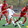 FVHS12<br /> Fairview's Janina Korba passes the ball beyond the reach of Smoky Hill players Candace Cephers, left, and Shelby Wesley, right. <br /> Photo by Marty Caivano/Camera/May 18, 2010