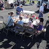 Customers eat food from vendors during the first Farmers Market at Holy Comforter Church on Tuesday.<br /> June 14, 2011<br /> staff photo/David R. Jennings