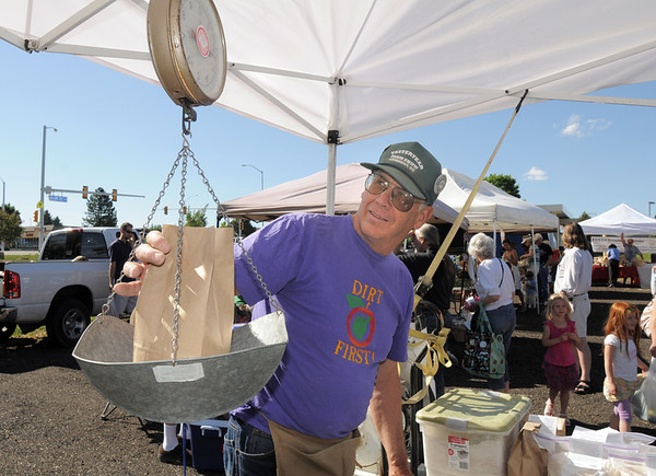John Ellis, Butte Mill, weighs a bag of flour at the first Farmers Market at Holy Comforter Church on Tuesday.<br /> June 14, 2011<br /> staff photo/David R. Jennings