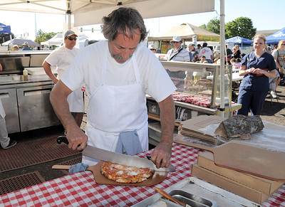 Arthur Greenwald, Laudisio Pizza, cuts a pizza for a customer during the first Farmers Market at Holy Comforter Church on Tuesday. June 14, 2011 staff photo/David R. Jennings