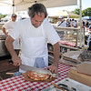Arthur Greenwald, Laudisio Pizza, cuts a pizza for a customer during the first Farmers Market at Holy Comforter Church on Tuesday.<br /> June 14, 2011<br /> staff photo/David R. Jennings
