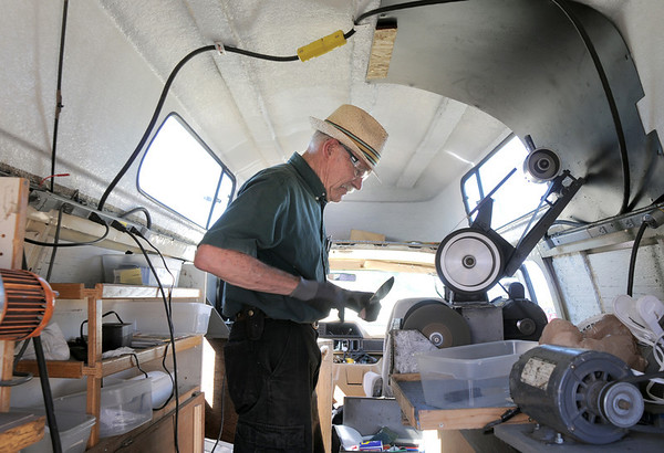 Duane Johnson Sharpening, sharpens a customer's knife in his van during the first Farmers Market at Holy Comforter Church on Tuesday.<br /> June 14, 2011<br /> staff photo/David R. Jennings