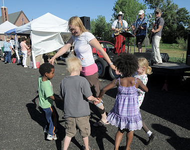 Angela Dormish, center dances with her children Tony, 5, left, Ryan, 6, Addie, 6, and Maegan, 8, to the live music of The Drifters band during the first Farmers Market at Holy Comforter Church on Tuesday. June 14, 2011 staff photo/David R. Jennings