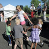 Angela Dormish, center dances with her children Tony, 5, left, Ryan, 6, Addie, 6, and Maegan, 8, to the live music of The Drifters band during the first Farmers Market at Holy Comforter Church on Tuesday.<br /> June 14, 2011<br /> staff photo/David R. Jennings