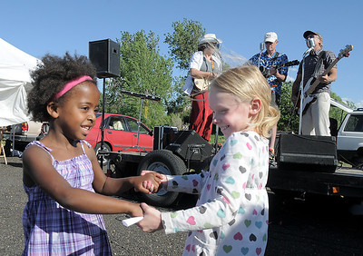 Addie Dormish, 6, left, dances with her sister Maegan Dormish, 8, to the live music of The Drifters band during the first Farmers Market at Holy Comforter Church on Tuesday. June 14, 2011 staff photo/David R. Jennings