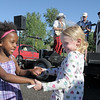 Addie Dormish, 6, left, dances with her sister Maegan Dormish, 8, to the live music of The Drifters band during the first Farmers Market at Holy Comforter Church on Tuesday.<br /> June 14, 2011<br /> staff photo/David R. Jennings