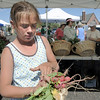 Alyssa Mallard, 11, prepares raddishes for sale at the Miller Farms booth during the first Farmers Market at Holy Comforter Church on Tuesday.<br /> June 14, 2011<br /> staff photo/David R. Jennings