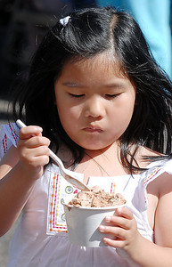 Madelyn Quinn, 6, eats some ice cream during the first Farmers Market at Holy Comforter Church on Tuesday. June 14, 2011 staff photo/David R. Jennings