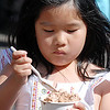 Madelyn Quinn, 6, eats some ice cream during the first Farmers Market at Holy Comforter Church on Tuesday.<br /> June 14, 2011<br /> staff photo/David R. Jennings