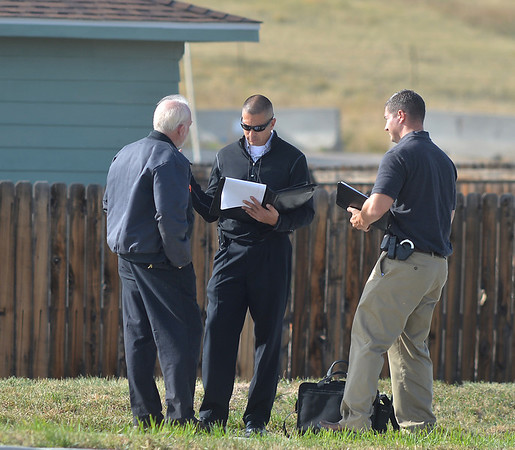 Broomfield Police officers interview a witness at the scene of a fatal shooting at 155 Commerce St. on Friday in Broomfield.<br /> October 12, 2012<br /> staff photo/ David R. Jennings