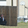 An employee of East of Sweden sits by a fence after the fatal shooting across from the business at 155 Commerce St. on Friday in Broomfield.<br /> October 12, 2012<br /> staff photo/ David R. Jennings