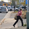 A woman runs to her car at the scene of a fatal shooting at 155 Commerce St.  on Friday in Broomfield.<br /> October 12, 2012<br /> staff photo/ David R. Jennings