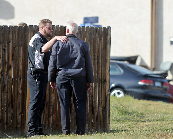 Witnesses comfort each other after a shooting at 155 Commerce St.  on Friday in Broomfield.<br /> October 12, 2012<br /> staff photo/ David R. Jennings