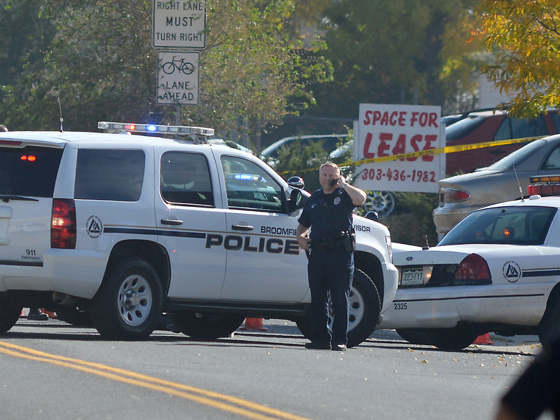 Broomfield Police officers at the scene of a fatal shooting at 155 Commerce St. on Friday in Broomfield.<br /> October 12, 2012<br /> staff photo/ David R. Jennings