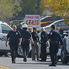 Broomfield Police officers gather to investigate a fatal shooting a possible bomb threat at 155 Commerce St. on Friday in Broomfield.<br /> October 12, 2012<br /> staff photo/ David R. Jennings