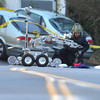 An Adams County Bomb Squad officer, with the aid of a robot, searches the contents of a suspects car for a bomb at the scene of a fatal shooting at 155 Commerce St. on Friday in Broomfield.<br /> October 12, 2012<br /> staff photo/ David R. Jennings