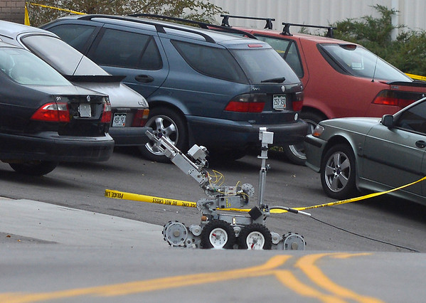 An Adams County Bomb Squad robot approaches a car at 155 Commerce St. where a shooting took place on Friday in Broomfield.<br /> October 12, 2012<br /> staff photo/ David R. Jennings