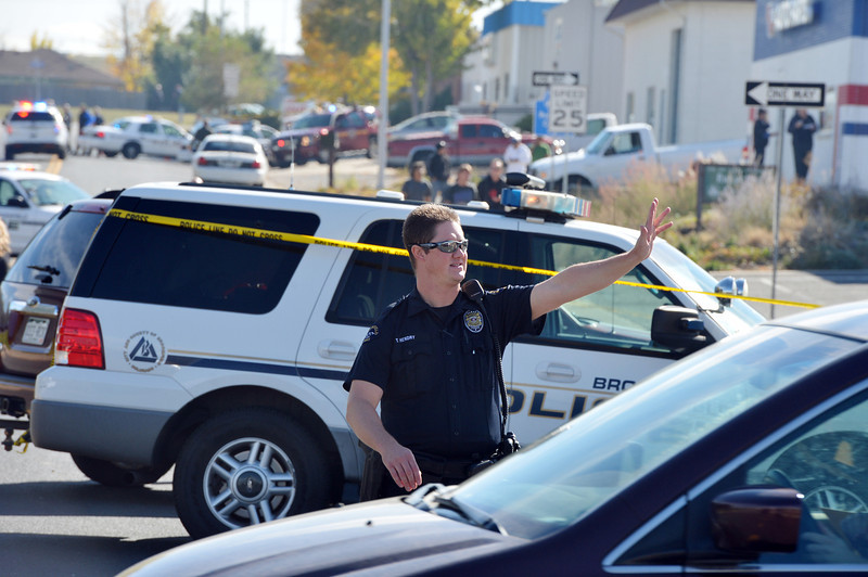 Broomfield Police officers direct traffic around the scene of a fatal shooting at 155 Commerce St. on Friday in Broomfield.<br /> October 12, 2012<br /> staff photo/ David R. Jennings