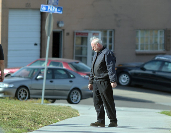 A witness stands on the sidewalk across the street from 155 Commerce St. where a shooting took place on Friday in Broomfield.<br /> October 12, 2012<br /> staff photo/ David R. Jennings