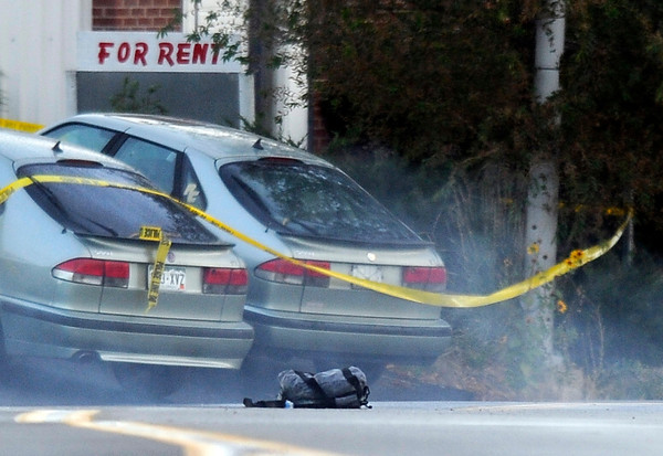 Fatal Shooting in Broomfield001.JPG Smoke billows from a backpack found in a vehicle after the bomb squad used a robot to detonate it at the scene of a fatal shooting at a business in the 100 block of Commerce Road in Broomfield on Friday, Oct. 12.<br /> Jeremy Papasso/ Camera