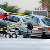 Fatal Shooting in Broomfield003.JPG A robot inspects a backpack found in a vehicle at the scene of a fatal shooting at a business in the 100 block of Commerce Road in Broomfield on Friday, Oct. 12.<br /> Jeremy Papasso/ Camera