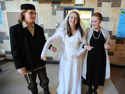 Austin Baltzer, left, Kali Zack and Hannah Trip prepare to walk down the isle for the wedding ceremony during rehearsal of  Broomfield Heights Middle School production of Fiddler on the Roof on Thursday.  March 15,  2012  staff photo/ David R. Jennings