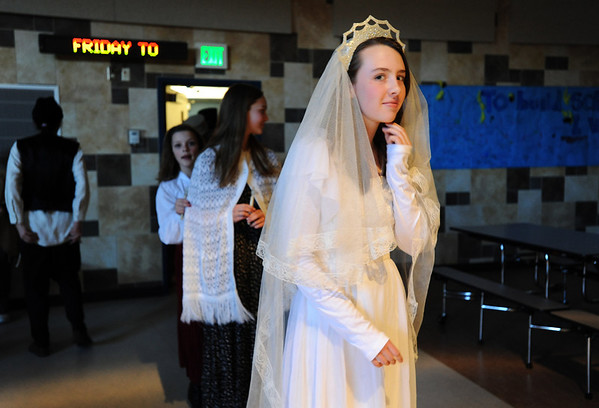 Kali Zack, Tzeitel, prepares for the wedding ceremony during rehearsal of  Broomfield Heights Middle School production of Fiddler on the Roof on Thursday.<br /> <br /> March 15,  2012 <br /> staff photo/ David R. Jennings