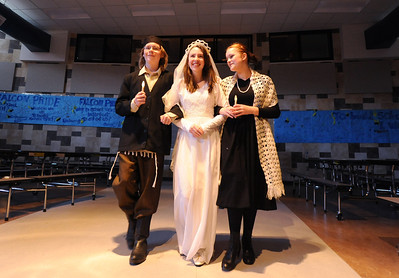 Kali Zack, center, Tzeitel, walks with Austin Baltzer, left, Tevya, and Hannah Tripp, Golde, for the waedding ceremony during rehearsal of  Broomfield Heights Middle School production of Fiddler on the Roof on Thursday.  March 15,  2012  staff photo/ David R. Jennings