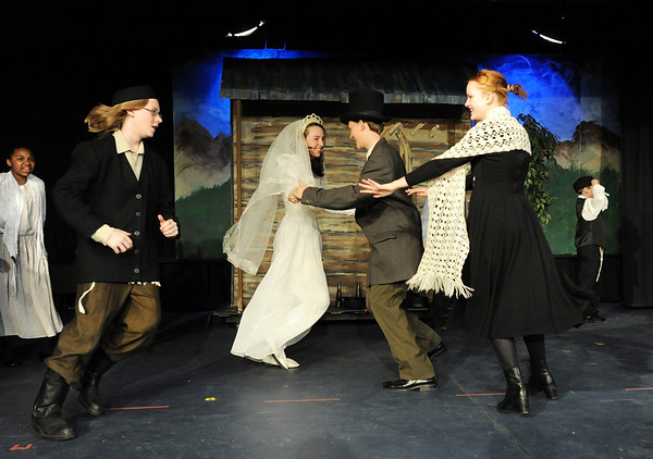 Kali Zack, Tzeitel, dances with Grant Holman, Motlel, center, with Austin Baltzer, Tevya, left, and Hannah Tripp, Golde, during rehearsal of  Broomfield Heights Middle School production of Fiddler on the Roof on Thursday.<br /> <br /> March 15,  2012 <br /> staff photo/ David R. Jennings