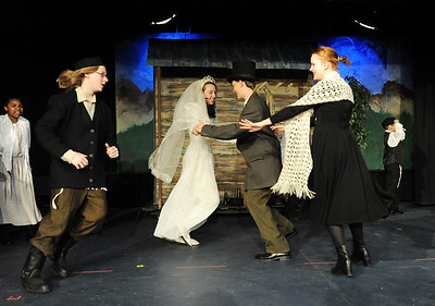 Kali Zack, Tzeitel, dances with Grant Holman, Motlel, center, with Austin Baltzer, Tevya, left, and Hannah Tripp, Golde, during rehearsal of  Broomfield Heights Middle School production of Fiddler on the Roof on Thursday.  March 15,  2012  staff photo/ David R. Jennings