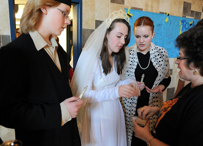 Adrienne Terzoni, right, has Kali Zack, center, choose a ring for the weddding ceremony while Ausitn Baltzer, left and Hannah Tripp watch during rehearsal of  Broomfield Heights Middle School production of Fiddler on the Roof on Thursday.  March 15,  2012  staff photo/ David R. Jennings