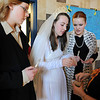 Adrienne Terzoni, right, has Kali Zack, center, choose a ring for the weddding ceremony while Ausitn Baltzer, left and Hannah Tripp watch during rehearsal of  Broomfield Heights Middle School production of Fiddler on the Roof on Thursday.<br /> <br /> March 15,  2012 <br /> staff photo/ David R. Jennings