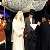 Kali Zack, Tzeitel, and Grant Holman, Motel, are wed by Bryce Gordon, the Rabbi, during rehearsal of  Broomfield Heights Middle School production of Fiddler on the Roof on Thursday.<br /> <br /> March 15,  2012 <br /> staff photo/ David R. Jennings
